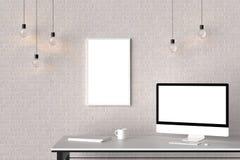 Espace de travail moderne avec le cadre vide d'isolement sur le mur de briques et l'OIN Images stock