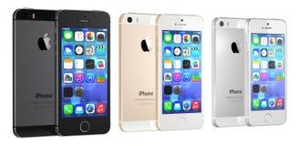 Espacie el gris, el oro y el iPhone de plata 5s en blanco Foto de archivo libre de regalías