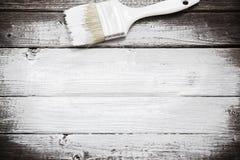 Espacio blanco de la pintura con la brocha Fotos de archivo libres de regalías