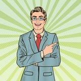 Espacio de Art Smiling Businessman Pointing Copy del estallido Imágenes de archivo libres de regalías