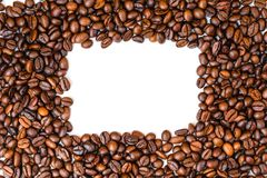Espacio de la copia de la opinión superior de los granos de café, tierra trasera del blanco imagen de archivo