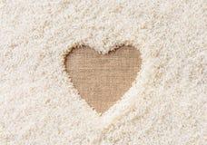 Espacio del fondo del arroz en el medio de un corazón Fotografía de archivo
