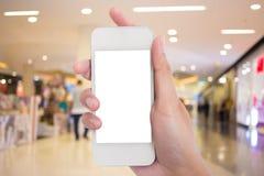 Espacio en blanco de la foto Dé a control la tarjeta de visita en blanco en la alameda de compras Imágenes de archivo libres de regalías