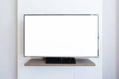 Espacio en blanco de la pantalla de la televisión de la TV en el fondo blanco de la pared Con clippi Imagen de archivo libre de regalías