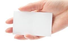 Espacio en blanco de la tarjeta en una mano Imagen de archivo libre de regalías