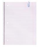Espacio en blanco. Papel del cuaderno y clip de papel aislados en el fondo blanco. De nuevo a escuela Fotografía de archivo libre de regalías