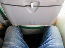 Espacio para las piernas apretado Imagen de archivo libre de regalías