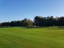 Espacios abiertos y verdes del campo de golf del golf fotografía de archivo libre de regalías