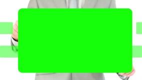Espacios de la copia del hombre de negocios que activan en la pantalla táctil metrajes