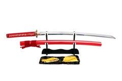 Espada de Katana Japanese no suporte preto Fotos de Stock