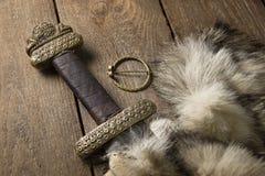 Espada de Viking em uma pele Fotos de Stock Royalty Free