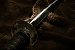 Espada del samurai en luz Imagen de archivo