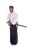 Espada del woth del entrenamiento del mastrer del Aikido Fotografía de archivo