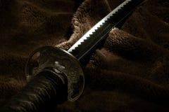 Espada do samurai na luz Imagem de Stock