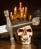 Espada e crânio Fotos de Stock