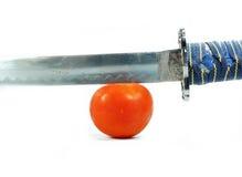 Espada e tomate Fotos de Stock Royalty Free