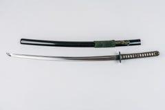 Espada japonesa isolada no branco Iaito da espada do treinamento de Iaido Imagem de Stock