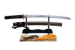 Espada japonesa no suporte Imagens de Stock