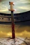 Espada na areia imagens de stock royalty free