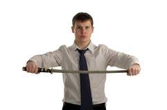 Espada séria da preensão do homem de negócios Imagem de Stock