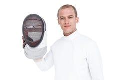 Espadachín que lleva a cabo la máscara de cercado Fotos de archivo libres de regalías