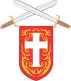 Espadas cruzadas con el escudo de la Cruz Roja Foto de archivo libre de regalías