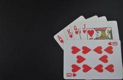 Espadas reales del flash del casino de las tarjetas que juegan póker juego fotografía de archivo libre de regalías