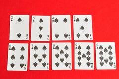 Espadas reales del flash del casino de las tarjetas que juegan Imagen de archivo