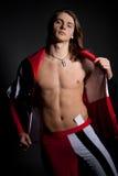 Espadelador vestido como um palhaço com um corpo bonito Fotografia de Stock Royalty Free