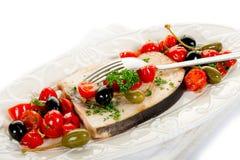 Espadons avec des câpres de tomates Photographie stock