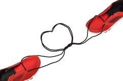 Espadrilles attachant la dentelle à la forme de coeur Photos libres de droits