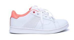 Espadrilles blanches sur le fond blanc sport de chaussures Images stock