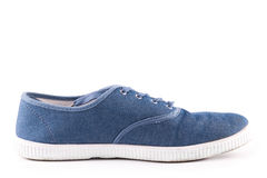 Espadrilles bleues d'isolement Photos libres de droits