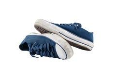 Espadrilles bleues d'isolement sur le fond blanc Photographie stock libre de droits