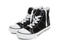 Espadrilles (chaussures de tennis) au-dessus de blanc Photos libres de droits