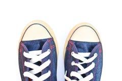 Espadrilles de jeans sur le blanc Images stock