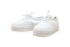 Espadrilles de paires, fond d'isolement par couleur blanche Image libre de droits