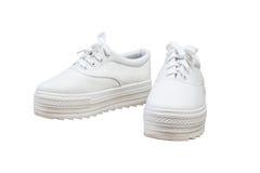 Espadrilles de paires, fond d'isolement par couleur blanche Images libres de droits
