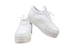 Espadrilles de paires, fond d'isolement par couleur blanche Images stock