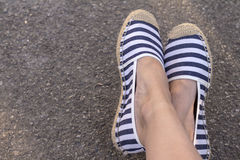 Espadrilles and legs. On the background Stock Image