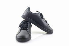 Espadrilles noires Chaussure de toile Photos libres de droits