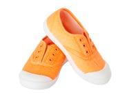Espadrilles oranges de tissu de bébé Photographie stock libre de droits