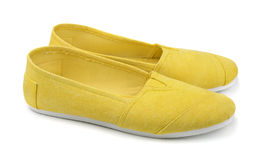 Espadrilles. Pair of yellow canvas espadrilles isolated on white Stock Image