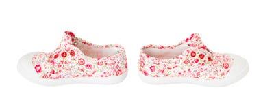 Espadrilles roses de bébé avec le modèle floral Images libres de droits