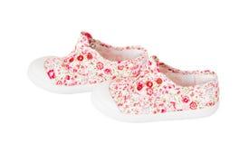 Espadrilles roses de bébé avec le modèle floral Photos libres de droits