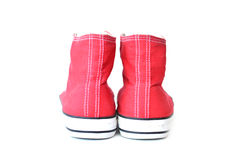 Espadrilles rouges sur le blanc Photographie stock