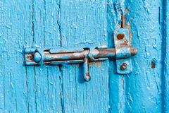 Espagnolette on old blue painted door Stock Images