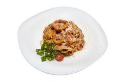 Espaguetes com anéis e queijo de cebolas Imagem de Stock
