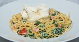 Espaguetes com espinafres Fotografia de Stock