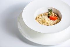 Espaguetes com tomate e queijo Fotografia de Stock